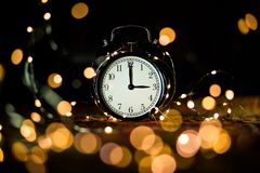 Alarm clock in anticipation of the holiday royalty free stock photography