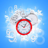 Alarm clock with figures and white gears. Blue background Stock Photos