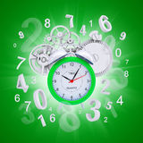 Alarm clock with figures and white gears. Green background Royalty Free Stock Image