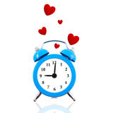 Alarm clock with floating red hearts Stock Photo