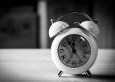 Alarm clock on the floor black and white Royalty Free Stock Images