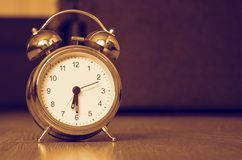 Alarm clock on the floor. Classic alarm clock on the floor Royalty Free Stock Images