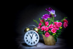 Alarm clock with flower Stock Images