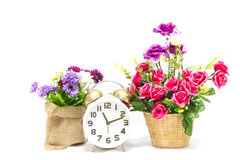 Alarm clock with flower Stock Photos