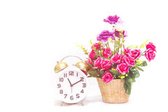 Alarm clock with flower Royalty Free Stock Photo