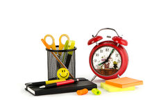 Alarm clock, folder and pen Stock Images