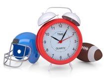 Alarm clock, football helmet and ball Royalty Free Stock Photo