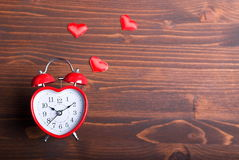 Alarm clock in the form of heart Stock Photography