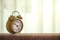 Alarm clock front of curtain stock images