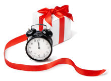 Alarm clock with gift Royalty Free Stock Images