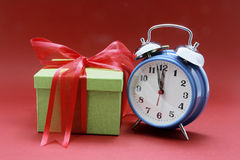 Alarm Clock and Gift Box Royalty Free Stock Photography