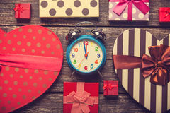 Alarm clock and gifts Royalty Free Stock Photos