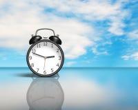 Alarm clock on glass table Royalty Free Stock Photo