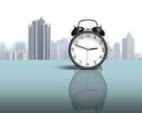 Alarm clock on glass table with city view Royalty Free Stock Photos