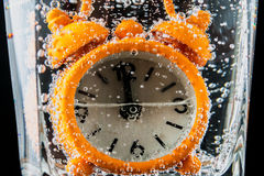 Alarm clock in a glass Royalty Free Stock Photo