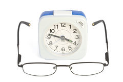 Alarm clock and glasses Royalty Free Stock Image