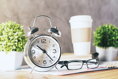 Alarm clock and glasses Stock Photos