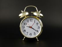 Alarm clock gold Stock Image