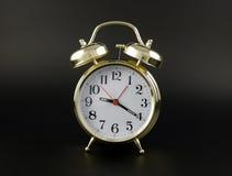 Alarm clock gold Stock Image