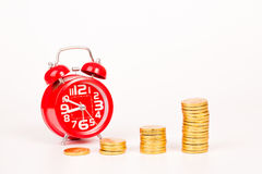 Alarm clock and gold coin Royalty Free Stock Photos