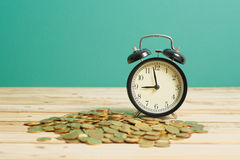 Alarm Clock with Gold Coins - Financial Wealth Concept Royalty Free Stock Image