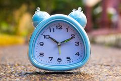 Alarm Clock on ground Royalty Free Stock Image