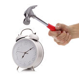 Alarm clock and hammer Stock Photos