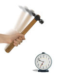 Alarm clock and hammer in hand Royalty Free Stock Photos