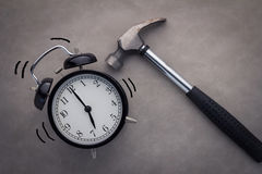 Alarm clock with hammer. O grey background Stock Photography