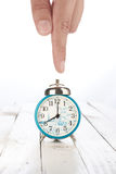 Alarm clock with hand Stock Photos