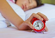 Alarm clock on hand. In the bedroom Royalty Free Stock Image