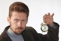 Alarm clock in hand Stock Images