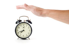 Alarm clock and hand Royalty Free Stock Photo