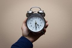 Holding alarm clock 2018 royalty free stock photography