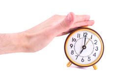 Alarm clock and hand Stock Image