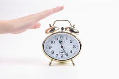 Alarm clock with hand Royalty Free Stock Photos