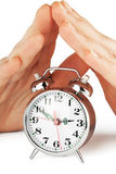 Alarm clock with hands Stock Photography