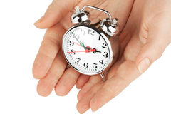 Alarm clock with hands Stock Photo