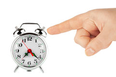 Alarm clock with hands Stock Images