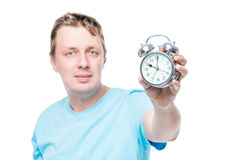 An alarm clock in the hands of a man close-up in focus Royalty Free Stock Photography
