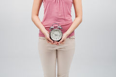 Alarm clock in hands of woman Royalty Free Stock Photo