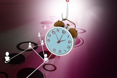 Alarm clock hanging the fish hook. In color background Stock Photography
