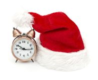 Alarm clock on the hat of Santa Claus Royalty Free Stock Photography