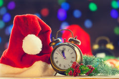 Alarm clock and hat Stock Photography