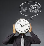 Alarm clock on head Stock Photo