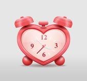 Alarm clock in heart shape Stock Photos