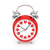 Alarm clock with hearts Royalty Free Stock Photos