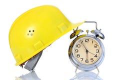 Alarm clock and helmet Royalty Free Stock Photos