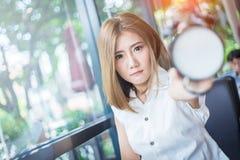 Alarm clock holding by beauty asia girl Stock Photos