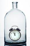 Alarm Clock Inside An Bottle. Stock Image